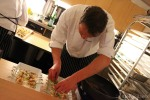 Chefs prepare food samples in the kitchen