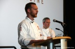 Chef Ryan Stone addresses event attendees