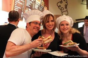 Contestants pose with their sandwiches
