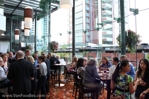 Event guests enjoy food and drinks