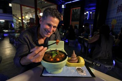 Eating out of plastic toilet bowl in Taipei - Photo Credit: The Show's Facebook Page