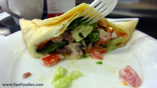 Check out the egg sandwiched between the crepe layers