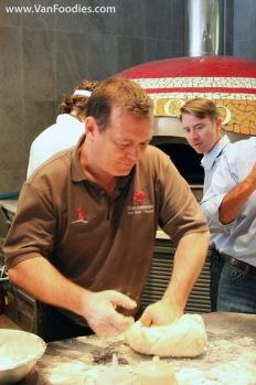 Roberto kneading the dough