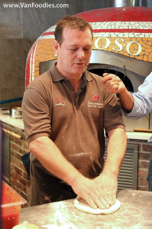 Roberto stretching the dough